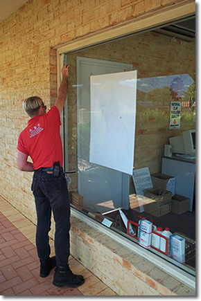 A window being professionally cleaned by ABC Window Cleaning Specialists